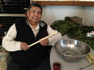 Elder Jim Toodlican teaching class how to make traditional whip from white willow  to make sxwusm